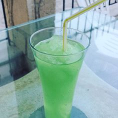 Homemade pina colada sorbet  #cheers #pinacolada #sorbet #frozen #green #glass #straw #drink #cocktail #homemade #summer #holiday #holidays #vacation #Halkidiki #Greece #instadrink #instacocktail #instalike