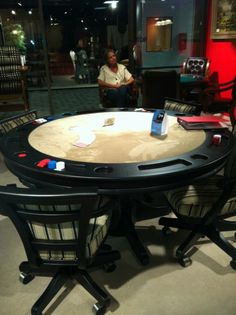 Poker Table...love the chairs! Gambling in style and confort ...oh yeah!