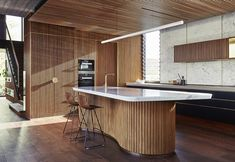 Roscommon House, a Brutalist villa in Australia designed by Neil Cownie, draws inspiration from styles of the past. See more photos from the stunning house. Interior Exterior, Interior Architecture, Interior Design, Design Interiors, Timber Dining Table, Timber Kitchen, Brutalist Buildings, Kitchen Island Bench, Cocinas Kitchen
