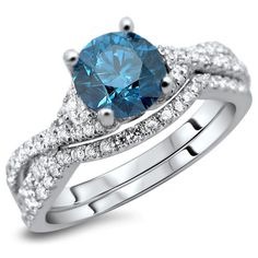 An excellent cut SI-1 clarity .75ct round blue diamond is placed atop this 1.50ct total weight ring and band set.