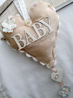Sweet baby sleeping heart door hanger.