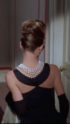 Audrey Hepburn as Holly GoLightly in Breakfast at Tiffany's, 1961