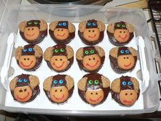 Monkey cupcakes. So easy! I added 2 mashed ripe bananas to a standard dark cocolate cake mix. Make them very light and moist. Iced with chocolate icing. Oatmeal snack pack cookies (halved) are the ears, Nilla cookies with the top cut off were the nose, icing nose and mouth, and mini M eyes. So easy and adorable! Curious George Party, Curious George Birthday, Chocolate Icing, Chocolate Cupcakes, Birthday Supplies, Party Supplies, Nilla Cookies, Monkey Cupcakes, Snack Pack