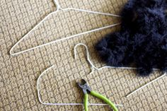 make a cat tail by wrapping fur/fabric around a wire hanger... I could use this for the top part of the skitty tail
