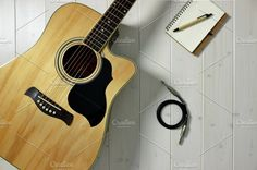 Acoustic Guitar on Wood Top & Cable by NikoKolev on @creativemarket