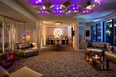 The new Extreme Wow Suite at the W New York—Times Square is a high-energy party venue. The hotel suite is designed to double as a reception space with room for 85 guests spread over its 1,200 square feet. Much of the furniture has double uses, such as the mirrored console in the entry that functions as a DJ booth and a buffet in the boardroom that is also a bar. The design reflects the Times Square location with features such as a light fixture that looks like a deconstructed Times Square…