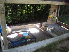 A sandbox with shade overhead
