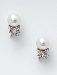 Pearl & Diamond Butterfly Cluster Earrings by Tara Pearls on Gilt.com  10 x 11mm white south sea cultured pearl stud earrings with butterfly shaped round cut diamond accents    Total diamond carat weight is 0.46  ¾ inches long  Post back closure