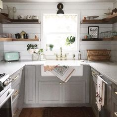 Grey lower cabinets, wood open shelving