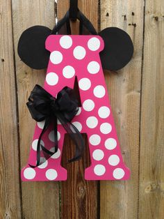 Letters are 18 tall and 1/2 thick. All letter are topped with black foam ears, black bow, and hanger. Any letter or color pair can be