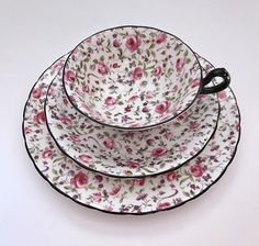 Beautiful vintage china tea cup trio made by Royal Chelsea in England. This is a very pretty trio with a chintz roses all over both the cup and saucer, with black trim. The pattern is often referred to as Briar Rose or Du Berry. It is in good condition, no chips, cracks or