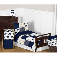 Big Bear 5 Piece Toddler Bedding Set will help you create an incredible room for your child. This designer patchwork bedding set uses an impressive array of exclusive fabrics combining a bear print, mini hexagon print and a metallic gold dot print combined with embroidery works of gold and navy arrows. This collection uses the stylish colors of navy blue, metallic gold and crisp white. This wonderful set will fit most standard cribs and toddler beds.