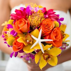love the starfish in this bright and cheery bouquet — so perfect for a beach wedding!