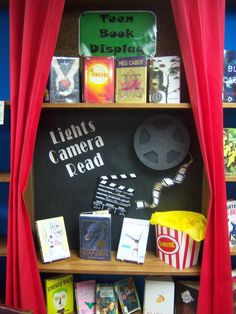 Movie Book Display....Coming Soon Board..Pick up popcorn containers at Target or make out of cardstock classroom-theme-ideas