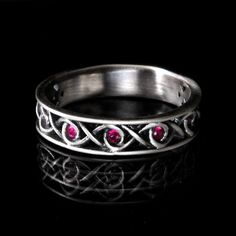 Hey, I found this really awesome Etsy listing at https://www.etsy.com/listing/113018829/celtic-ruby-wedding-ring-with-infinity