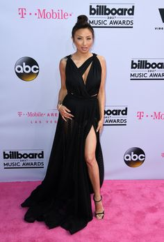 Dang! Jeannie Mai was pink-carpet perfection in a sultry black maxi that showed off a whole lot of leg. (And may we say, those are some toned thighs!) via @AOL_Lifestyle Read more: https://www.aol.com/article/entertainment/2017/05/21/best-dressed-billboard-music-awards-2017-celine-dion/22102539/?a_dgi=aolshare_pinterest#fullscreen