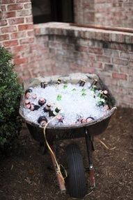 Drinks in wheel barrel                                                                                                                                                                                 More Bonfire Birthday Party, Birthday Cookout Ideas, Food For Graduation Parties, Decoration For Graduation Party, Fall Bonfire Party, Graduation Table Ideas, Bonfire Parties, Wedding Bonfire, 16th Birthday