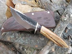 Behring Made Knives makes beautiful custom (completely handmade) hand forged scagel style knives, swords and axes using only the best grade steel and materials available.  Made in the USA.