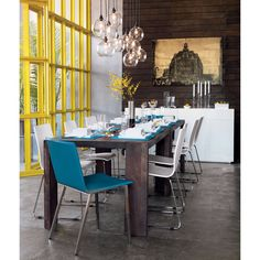 dining room - looks like our table and chairs!! interesting chandelier.