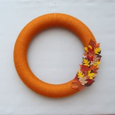 Rust Orange Yarn Wreath.  Door wreath with red, rust, yellow, bronze, and orange felt leaves. Perfect for harvest & fall decor. 14 Inches.. $54.00, via Etsy.