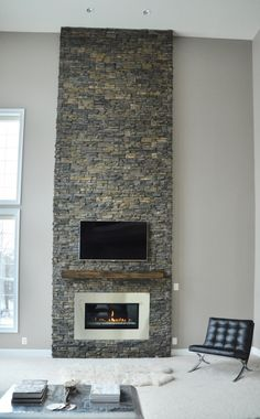 modern fireplace with stacked stone