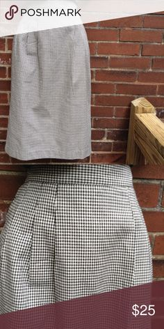 """Vintage 80s Classix Check Skirt Vintage 80s black and white check plaid skirt. Back button/zipper closure. Pleated at the waist. Side pockets. Back split 8.5"""". Waist 28"""" (has elastic in the sides) Hip 38"""" Length 26"""". Excellent vintage condition. Never worn. Vintage Skirts Midi"""