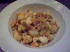Saffron risotto with lobster sauteed with garlic and butter.