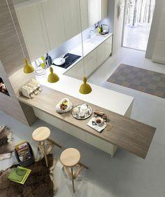 une jolie cuisine moderne avec ilot de cuisine central