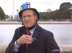 "Former U. representative for Georgia's congressional district cycling away wearing a Nutcase Helmet in a ""Know Your District"" video on Stephen Colbert Stephen Colbert, Helmets, Finals, Georgia, Cycling, Tv, Celebrities, Movies, How To Wear"