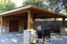 Carport with bricks.  wouldn't match our neighborhood...but wood columns with brick overlay is an idea...