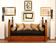 French empire antique bed paired with well framed art and black sculptures. i