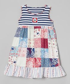This pretty piece's vibrant hues and comfy construction will make the urge to twirl completely irresistible. Its fanciful patchwork skirt and charming appliqué play sweetly with stripes. A darling ruffle and crinkly trim dance along the edges.