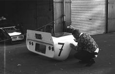 Someone polishing the rear clam of the Chaparral 2D. 1000 km race,Nurburgring 1966