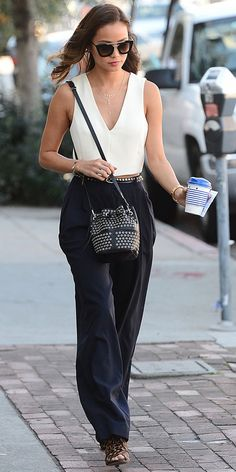 Jamie Chung rocking wide-leg trousers and a studded bucket bag