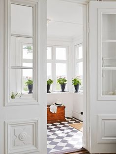 Fresh + simple entryway with natural light and checkered tile