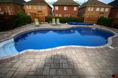 Intricate interlocking pavers adds charm to the pool area. Wood Pergola, Pergola Canopy, Deck With Pergola, Fiberglass Pool Installation, Fiberglass Pools, Pool Fence, Pool Decks, Patio Fence, Interlocking Pavers