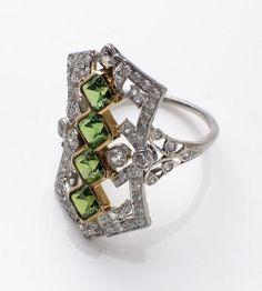 A demantoid garnet, diamond and platinum and gold ring