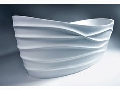 Wrapped in porcelain waves of imaginary wind sculpted dunes and majestic mountains the Dune Bathtub by Caroline Beaupere is a stunning oasis of calm and tranquility. http://www.trendir.com/archives/the-body-licious-dune-bathtub-by-caroline-beaupere.html