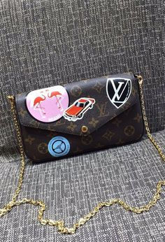 Louis Vuitton Monogram Canvas Pochette Felicie with Classic Hotel Stickers M63866.  Find more LV bags at http://www.luxtime.su/louis-vuitton-handbags