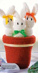 "These ""Potted Bunnies"" would make a cute Easter Decoration....pattern available in The Crochet World Collection 2001-2010."