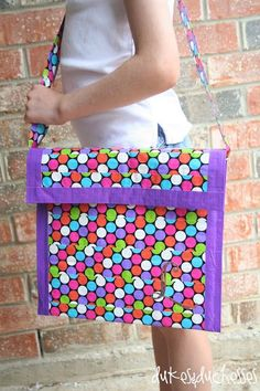 DIY monogrammed duct tape messenger bag made with a packing envelope