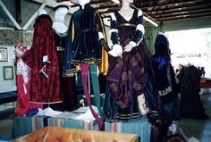 A Display at the 30 Year celebration in 1996. Love the center navy men's cotehardie. Gorgeous