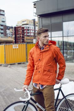 Striking. I want this bike. And the orange windbreaker. Ok, yes, and the guy. Yum. - The Homme Depot