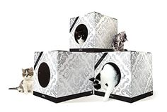 "Here's a new modular cat hideaway system from Cat Lovebox. These 15"" cubes are made from sturdy corrugated cardboard and assemble easily to create a place for cats to climb and rest. 8"" round openings are pre-cut on all sides so you can decide which side the opening should face or create multiple openings. Cat…"