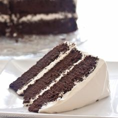 three layer chocolate cake with marshmallow frosting. Yes, folks, you read that correctly: MARSHMALLOW FROSTING. Chocolate Marshmallow Cake, Marshmallow Frosting Recipes, Tasty Chocolate Cake, Chocolate Cale, Marshmallow Cream, Caramel Frosting, Oreo Cake, Just Desserts, Delicious Desserts