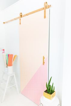 This DIY colorblocked barn door is a modern take on this well-loved sliding door trend!