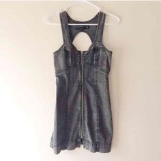 """Grudge Jean mini dress with open back New. Grudge style Jean mini dress with open back, size small, 32"""" long. Thank you for visiting my closet, please let me know if you have any questions, I offer great discounts on bundles :) Dresses Mini"""