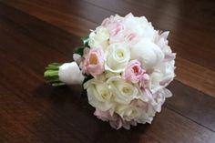 Formal Round Wedding Bouquet of White Peony Roses, Pale Pink Cymbidium Orchids, White Roses and Tulips.  Wedding Bouquet designed for The Bride's Tree Wedding Magazine Feature Article.