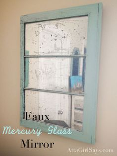 DIY faux mercury glass mirror from an old window. Learn how to make one with spray paint at AttaGirlSays.com