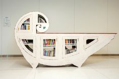 Nautilus, 2015, Katie Hudnall. Plywood, reclaimed wood, wood, fasteners & hardware, plexiglass, paint, ink, dye, lacquer, wax with two ink on paper drawings framed in wood by the artist.Nine Artist-Designed Miniature Book Sharing Libraries Appear in Indianapolis